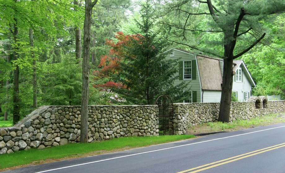 A view of the stone wall that Albert and Susan Hancock built around their home on Northside Lane. The Board of Selectmen approved on Wednesday a settlement and encroachment waiver that allows part of the wall to remain on the town-owned North Avenue. Photo: Paul Schott / Westport News
