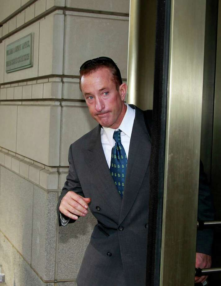 Brian McNamee, Roger Clemens' former trainer, leaves federal court in Washington after testifying Thursday in the former Major League Baseball pitcher's perjury trial. Photo: Haraz N. Ghanbari, Associated Press