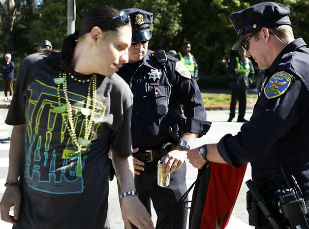 San Francisco Police officers confiscate cans of beer from a Bay to Breakers ...
