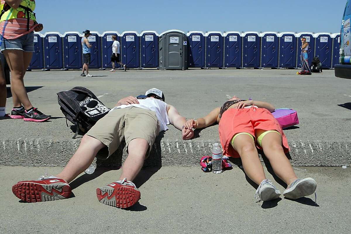 Two people resting not far from the finishing line during the 101st Bay to Breakers foot race in San Francisco, Calif. on May 20, 2012.