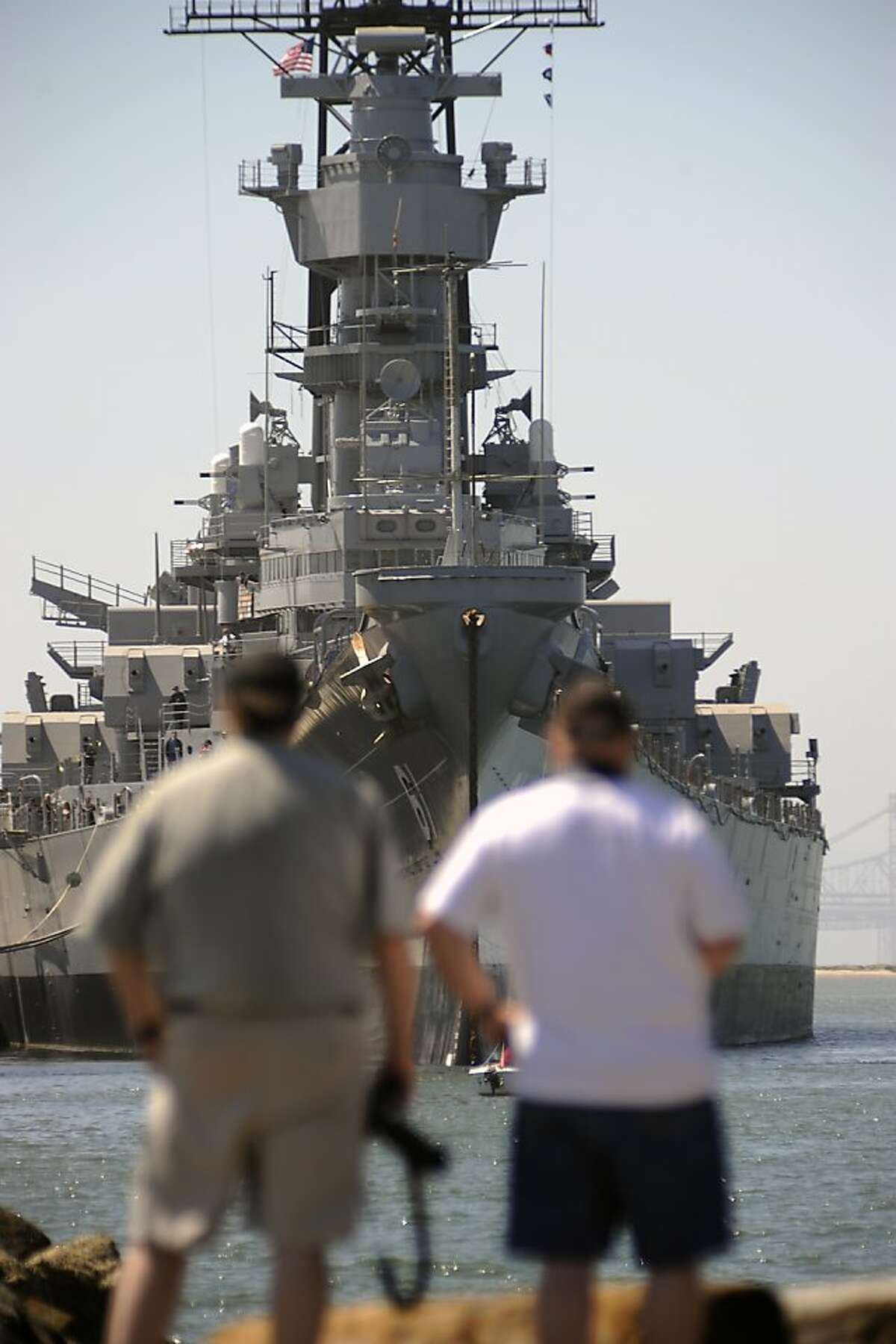 Visitors get a view of the USS Iowa BB-61 Battleship as it sits at dock in Richmond, CA Sunday May 20th, 2012. The Iowa was ready to be towed to Los Angeles today to become a permanent museum but the departure was delayed due to weather issues down the California coast.