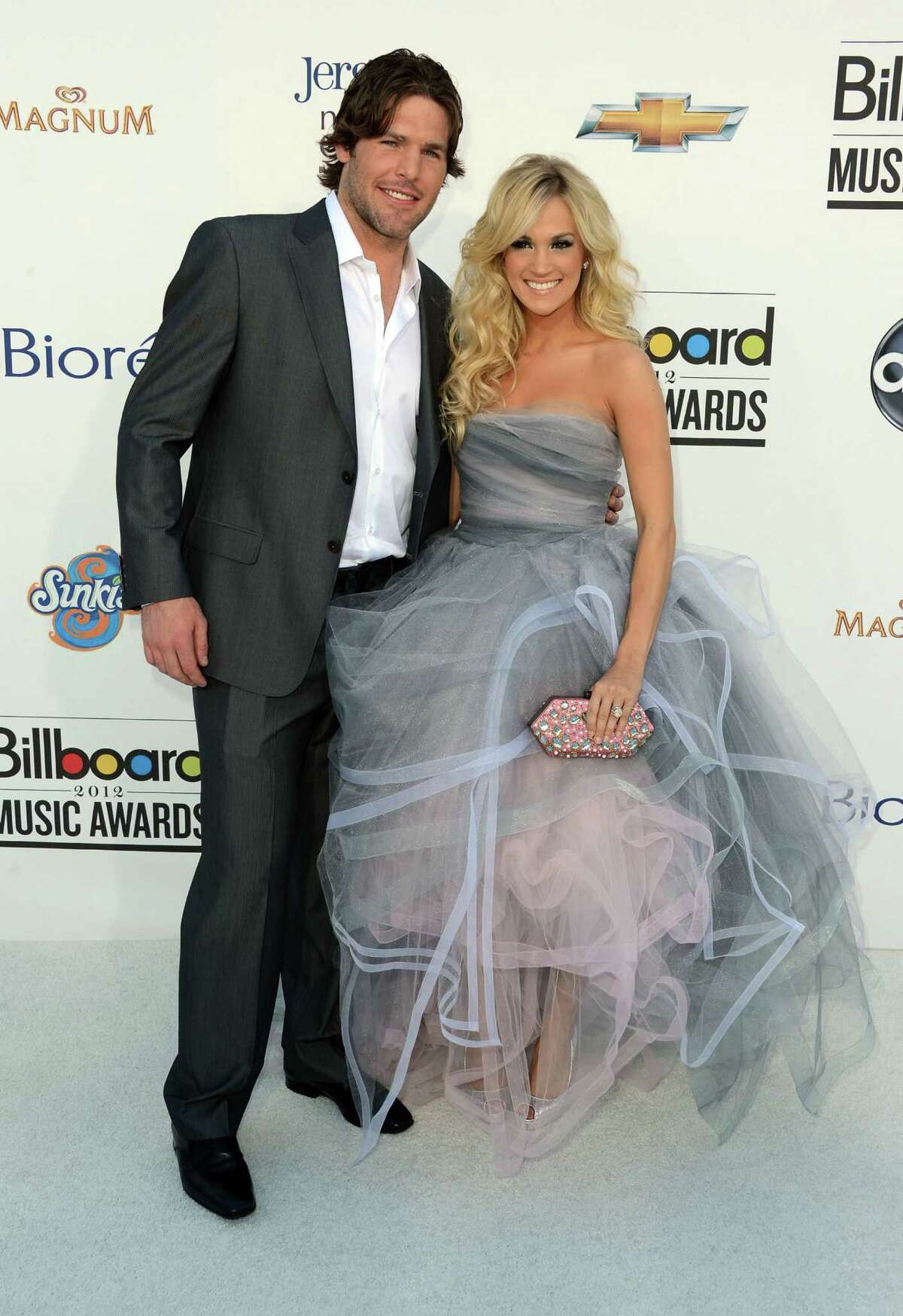 LAS VEGAS, NV - MAY 20: NHL hockey player Mike Fisher and Singer Carrie Underwood arrive at the 2012 Billboard Music Awards held at the MGM Grand Garden Arena on May 20, 2012 in Las Vegas, Nevada.
