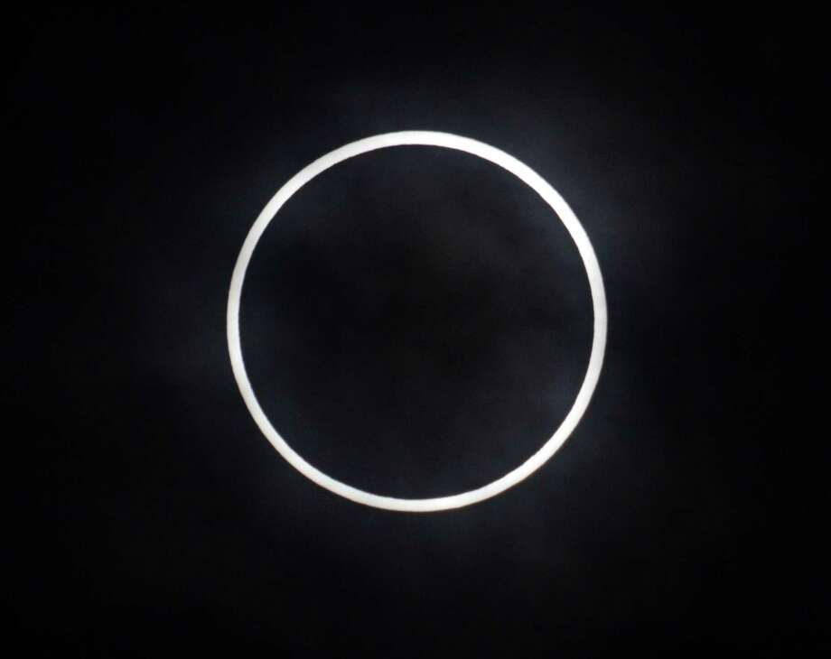 An annular solar eclipse is seen from Tokyo on May 21, 2012 . For the first time in 932 years, a swathe of the country was able to see the annular solar eclipse, when the moon passes in front of the sun, blocking out all but an outer circle of light. Photo: YOSHIKAZU TSUNO, AFP/Getty Images / AFP