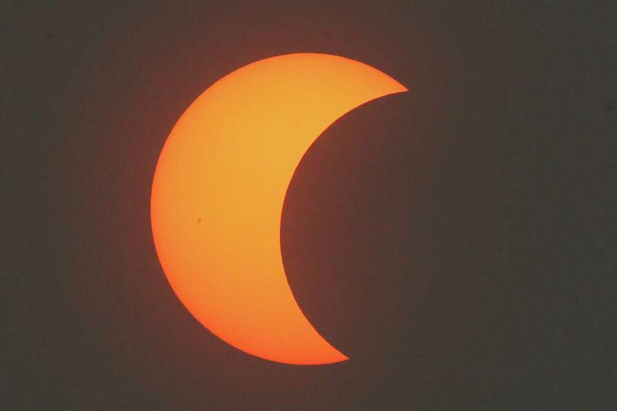 A partial annular solar eclipse is seen over Beijing, China, Monday, May 21, 2012. Millions of Asian