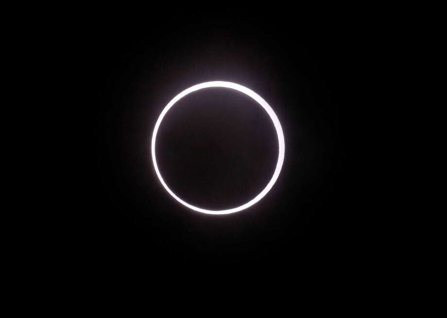 An annular solar eclipse appears in the sky over Yokohama near Tokyo Monday, May 21, 2012. The annular eclipse, in which the moon passes in front of the sun leaving only a golden ring around its edges, was visible to wide areas across China, Japan and elsewhere in the region before moving across the Pacific to be seen in parts of the western United States. Photo: AP