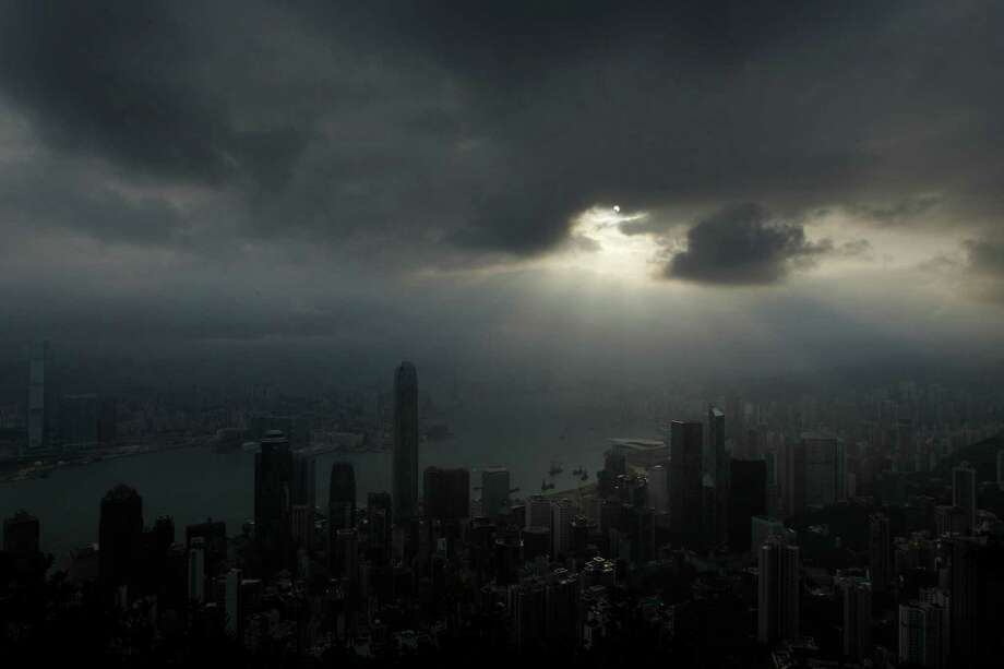 An annular solar eclipse appears in Hong Kong Monday, May 21, 2012. The annular eclipse, in which the moon passes in front of the sun leaving only a golden ring around its edges, was visible to wide areas across China, Japan and elsewhere in the region before moving across the Pacific to be seen in parts of the western United States. Photo: AP