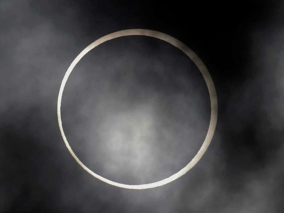 An annular solar eclipse appears in Fujisawa, near Tokyo, Monday, May 21, 2012. The annular eclipse, in which the moon passes in front of the sun leaving only a golden ring around its edges, was visible to wide areas across China, Japan and elsewhere in the region before moving across the Pacific to be seen in parts of the western United States. Photo: AP