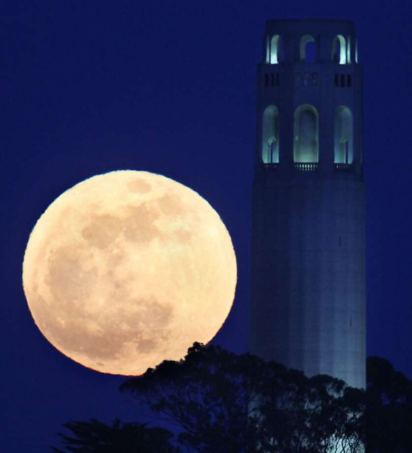 The May's full moon rises besided San Francisco Coit Tower in San Francisco on Saturday, May 5, 2012. (AP Photo/Frederic Larson, San Francisco Chronicle) Photo: Frederic Larson, Associated Press