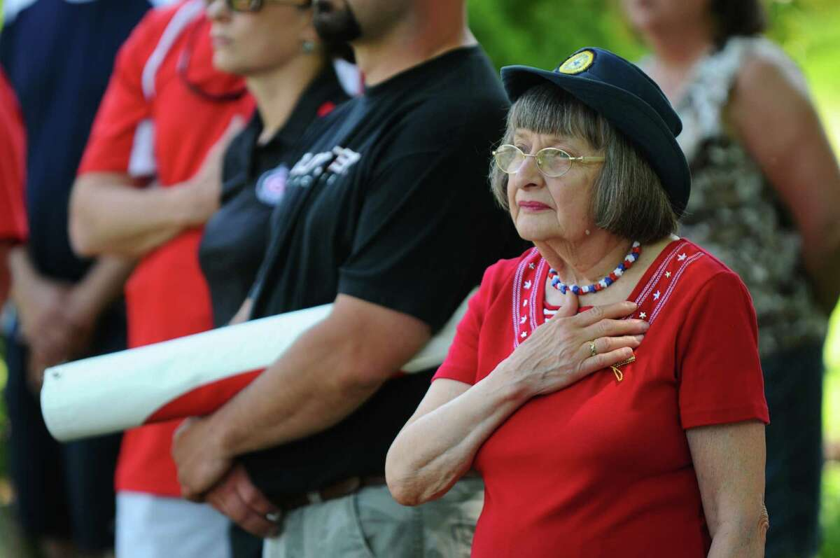 Jean Nachbar of Altamont pays respect during the singing of the National Anthem during Memorial Day ceremonies in Orsini Park following the annual parade, on Sunday May 20, 2012 in Altamont, NY. Jean is a member of the American Legion Auxiliary. (Philip Kamrass / Times Union )