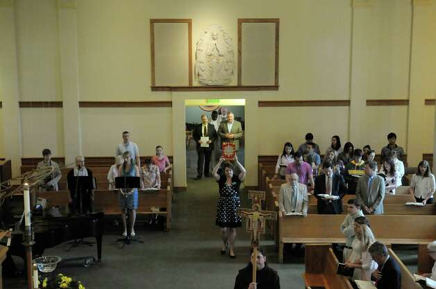 The procession enters the chapel during a service at St. Mary of the Angels Chapel on the campus of Siena College on Sunday, May 20, 2012 in Loudonville, NY.  Cardinal Peter Turkson, a native of Ghana, led the service.   The service was held for the nonprofit organization, Medicus In Christi, started by Dr. Joseph Marotta, a Siena graduate and the orthopedic surgeon for the college's athletic program.  The nonprofit was set up to help the people of Ghana.  (Paul Buckowski / Times Union) Photo: Paul Buckowski / 00017756A
