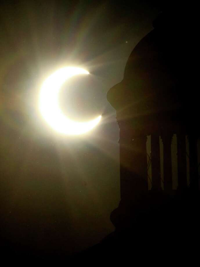 The state Capitol dome, in Sacramento, Calif., is silhouetted by an annular eclipse Sunday May 20, 2012.  The annular solar eclipse, in which the moon passes in front of the sun leaving only a golden ring around its edges, was partially seen over parts of the western United States. Photo: AP