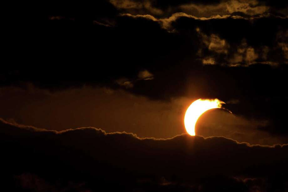 An annular eclipse appears Sunday, May 20, 2012, north of Odessa, Texas. The annular eclipse, in which the moon passes in front of the sun leaving only a golden ring around its edges, was visible to wide areas across China, Japan and elsewhere in the region before moving across the Pacific to be seen in parts of the western United States. Photo: AP