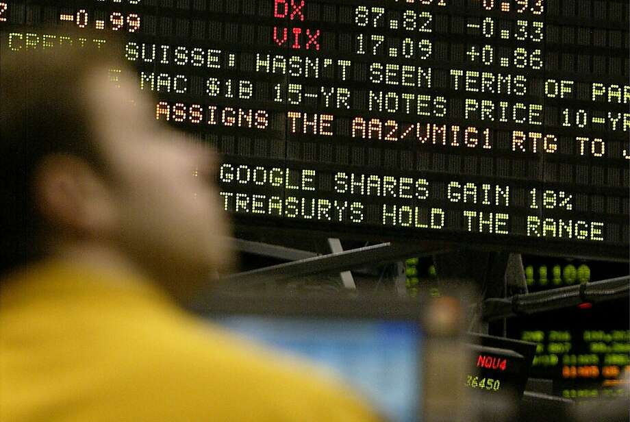 A clerk in the Nasdaq pit of the Chicago Mercantile Exchange looks up at a screen showing Google's gain. Photo: Frank Polich, Bloomberg News