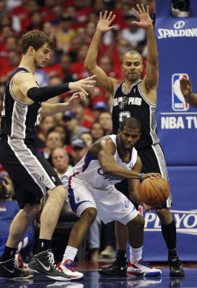 San Antonio Spurs' Tiago Splitter (22) and Tony Parker (09) pressure Los Angeles Clippers' Chris Paul (03) in the first quarter during game four of the Western Conference semifinals at Staples Center in Los Angeles, Sunday, May 20, 2012.  Jerry Lara/San Antonio Express-News (Jerry Lara / San Antonio Express-News)