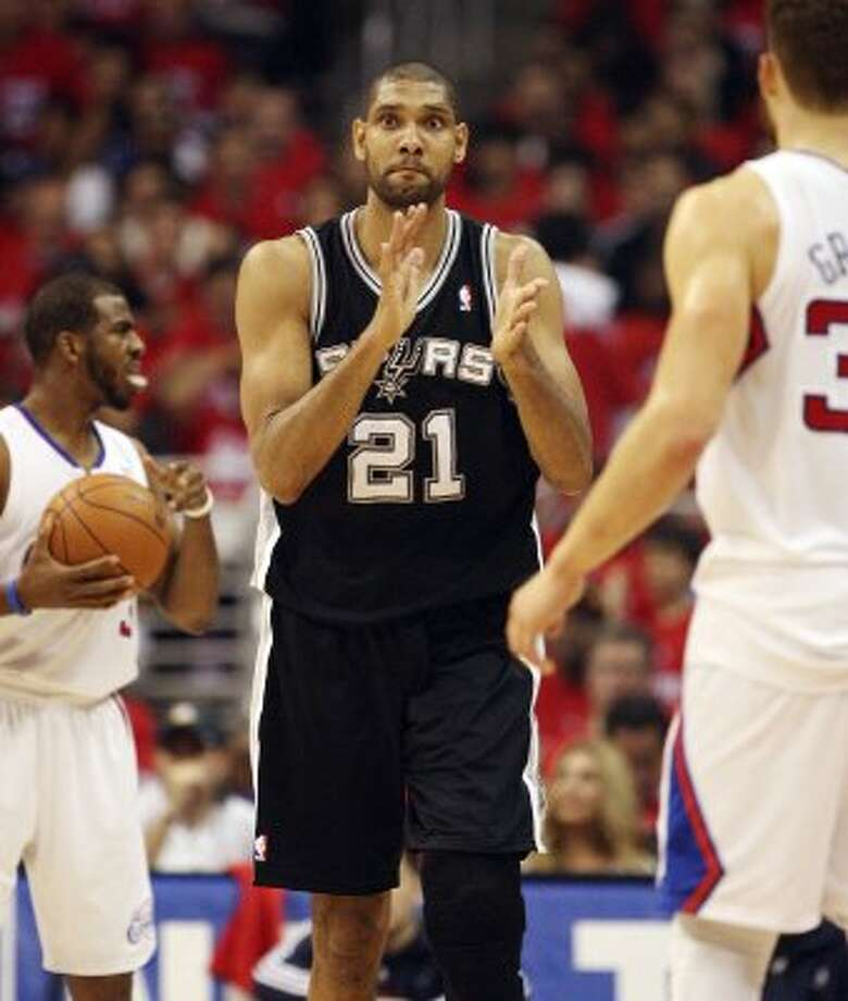 San Antonio Spurs' Tim Duncan (21) applauds after the Los Angeles Clippers turned over the ball in the first quarter during game four of the Western Conference semifinals at Staples Center in Los Angeles, Sunday, May 20, 2012.  Jerry Lara/San Antonio Express-News (Jerry Lara / San Antonio Express-News)