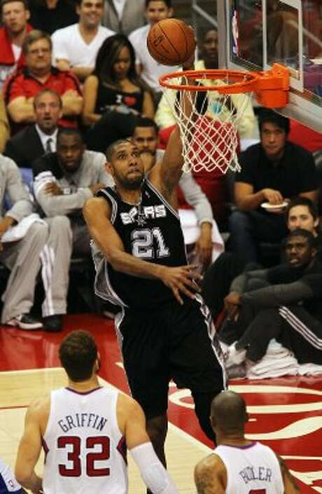 Spurs' Tim Duncan (21) goes in for a dunk against the Los Angeles Clippers' Blake Griffin (32) and Caron Butler (05) in the first half of game four of the Western Conference semifinals at the Staples Center in Los Angeles on Sunday, May 20, 2012. Kin Man Hui/Express-News (Kin Man Hui / SAN ANTONIO EXPRESS-NEWS)