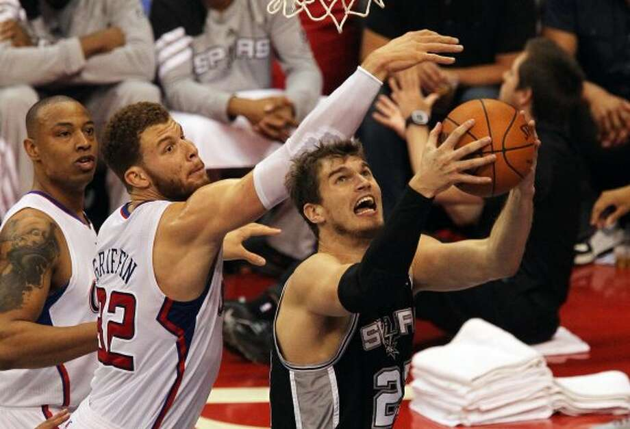 Spurs' Tiago Splitter (22) goes up for a shot against the Los Angeles Clippers' Blake Griffin (32) in the first half of game four of the Western Conference semifinals at the Staples Center in Los Angeles on Sunday, May 20, 2012. Kin Man Hui/Express-News (Kin Man Hui / SAN ANTONIO EXPRESS-NEWS)
