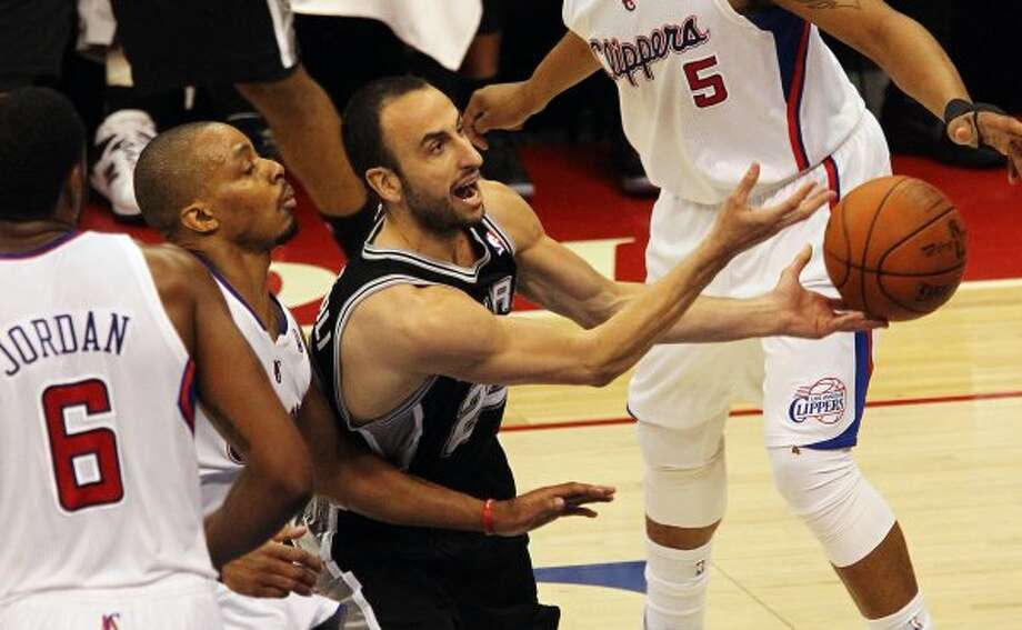 Spurs' Manu Ginobili (20) drives the basket against the Los Angeles Clippers in the first half of game four of the Western Conference semifinals at the Staples Center in Los Angeles on Sunday, May 20, 2012. Kin Man Hui/Express-News (Kin Man Hui / SAN ANTONIO EXPRESS-NEWS)