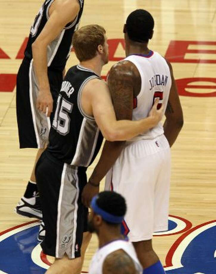 Spurs' Matt Bonner (15) intentionally fouls Los Angeles Clippers' DeAndre Jordan (06) in the first half of game four of the Western Conference semifinals at the Staples Center in Los Angeles on Sunday, May 20, 2012. Kin Man Hui/Express-News (Kin Man Hui / SAN ANTONIO EXPRESS-NEWS)
