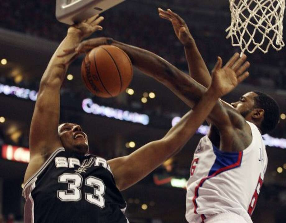 San Antonio Spurs' Boris Diaw (33) gets blocked by Los Angeles Clippers' DeAndre Jordan (06) in the first quarter during game four of the Western Conference semifinals at Staples Center in Los Angeles, Sunday, May 20, 2012.  Jerry Lara/San Antonio Express-News (Jerry Lara / San Antonio Express-News)