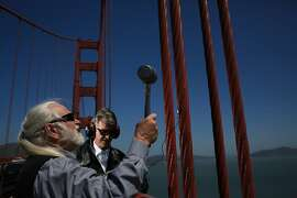 Using a rubber mallet and a vintage pickup attached to different parts of the Golden Gate Bridge with beeswax, Doug McKechnie and Paul de Benedictis record sounds on the bridge on May 10, 2012 in San Francisco, Calif. After recording the sounds they sample them in a synthesizer to make elaborate musical arrangements.  McKechnie started this project in 1975 and was joined by his student, de Benedictis in the early 1980s. Together they have made dozens of recordings in this manner.