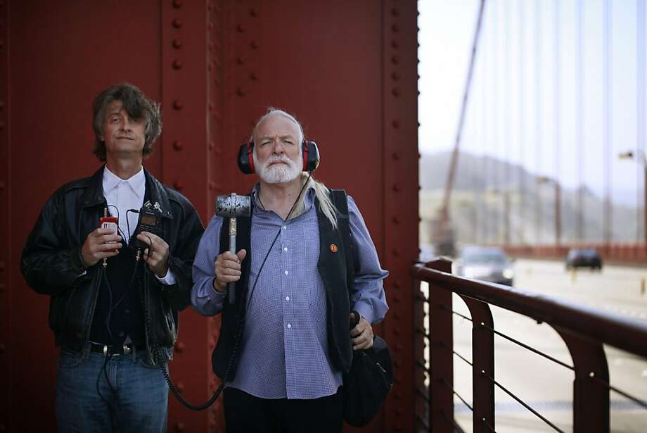Paul de Benedictis and Doug McKechnie stand at the base of south tower of the Golden Gate Bridge,  on May 10, 2012 in San Francisco, Calif., armed with recording gear that they have been using for decades to record sounds on the bridge. After recording the sounds they sample them in a synthesizer to make elaborate musical arrangements.  McKechnie started this project in 1975 and was joined by his student, de Benedictis in the early 1980s. Together they have made dozens of recordings in this manner. Photo: Mike Kepka, The Chronicle