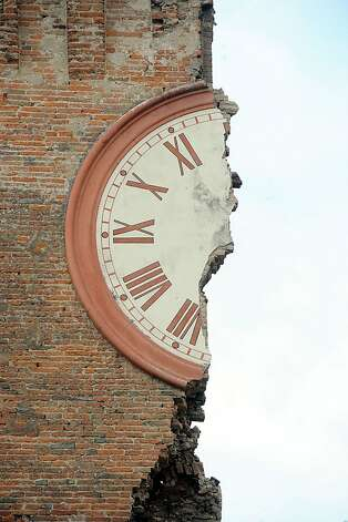 FERRARA, ITALY - MAY 20:  Modenesi's Towers of Finale Emilia are destroyed following an earthquake on May 20, 2012 in Ferrara, Italy.  At least four people were killed after the magnitude 6.0 quake - which destroyed many historic buildings - struck in the early hours. (Photo by Roberto Serra/Iguana Press/Getty Images) Photo: Roberto Serra/Iguana Press, Getty Images