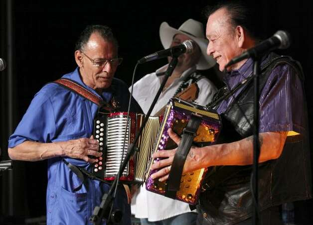 Santiago Jimenez Jr. (left) and his brother Flaco Jimenez perform during the Tejano Conjunto Festival Sunday, May 20, 2012, at Rosedale Park. (Edward A. Ornelas / San Antonio Express-News)