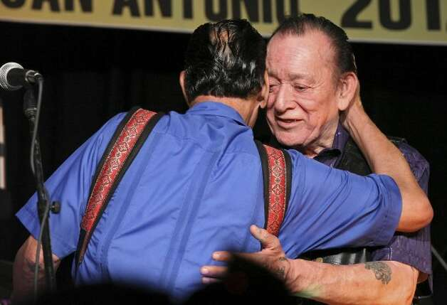 Santiago Jimenez Jr. (left) hugs his brother Flaco Jimenez during their performance at the Tejano Conjunto Festival Sunday, May 20, 2012, at Rosedale Park. (Edward A. Ornelas / San Antonio Express-News)