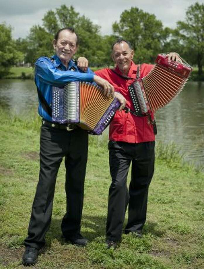 Flaco Jimenez (left) and Santiago Jimenez Jr. return to Woodlawn Lake on Tuesday, May 15, 2012, the backdrop for the cover of the album they recorded more than 50 years ago. (Darren Abate / For the Express-News)