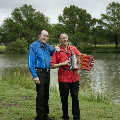 Flaco Jimenez (left) and Santiago Jimenez Jr. re-create the pose used on the only album they have recorded together during a photo shoot at Woodlawn Lake on Tuesday, May 15, 2012. (Darren Abate / For the Express-News)