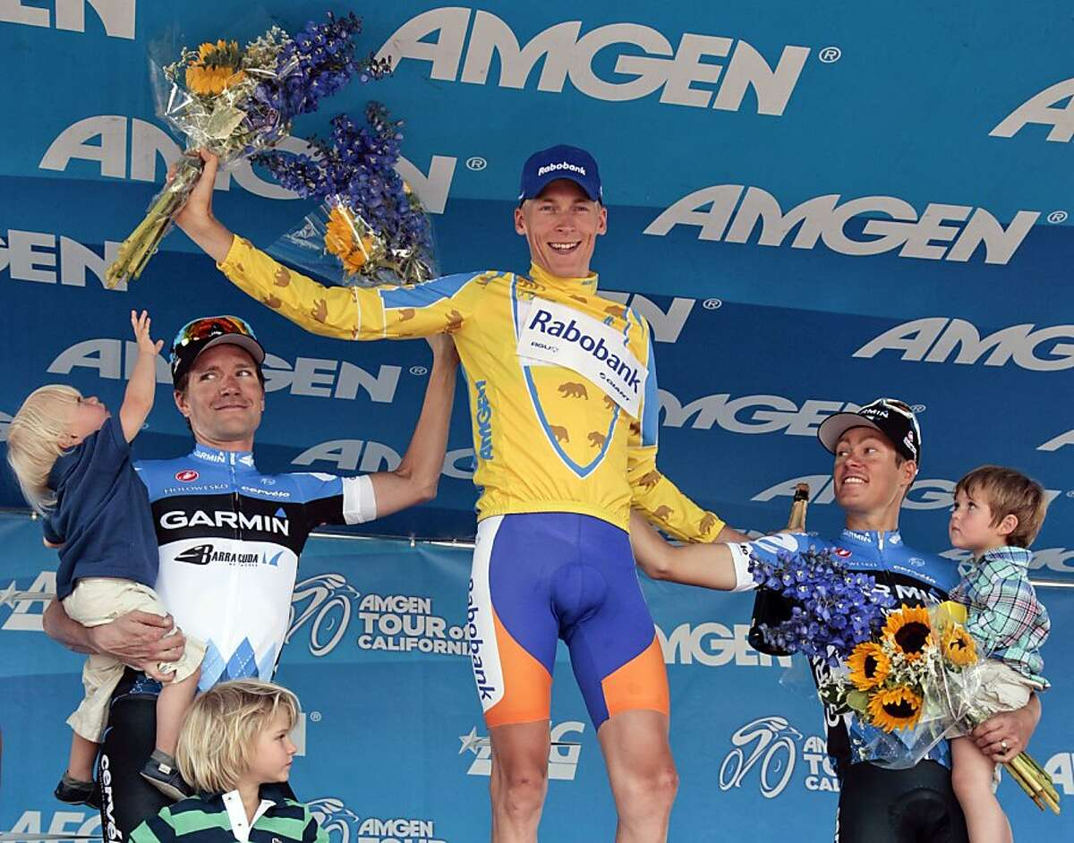 Robert Gesink, center, of the Netherlands, celebrates winning the Tour of California cycling race with David Zabriskie, left, and Tom Danielson, who finished second and third respectively, Sunday, May 20, 2012, in Los Angeles. (AP Photo/Jason Redmond)