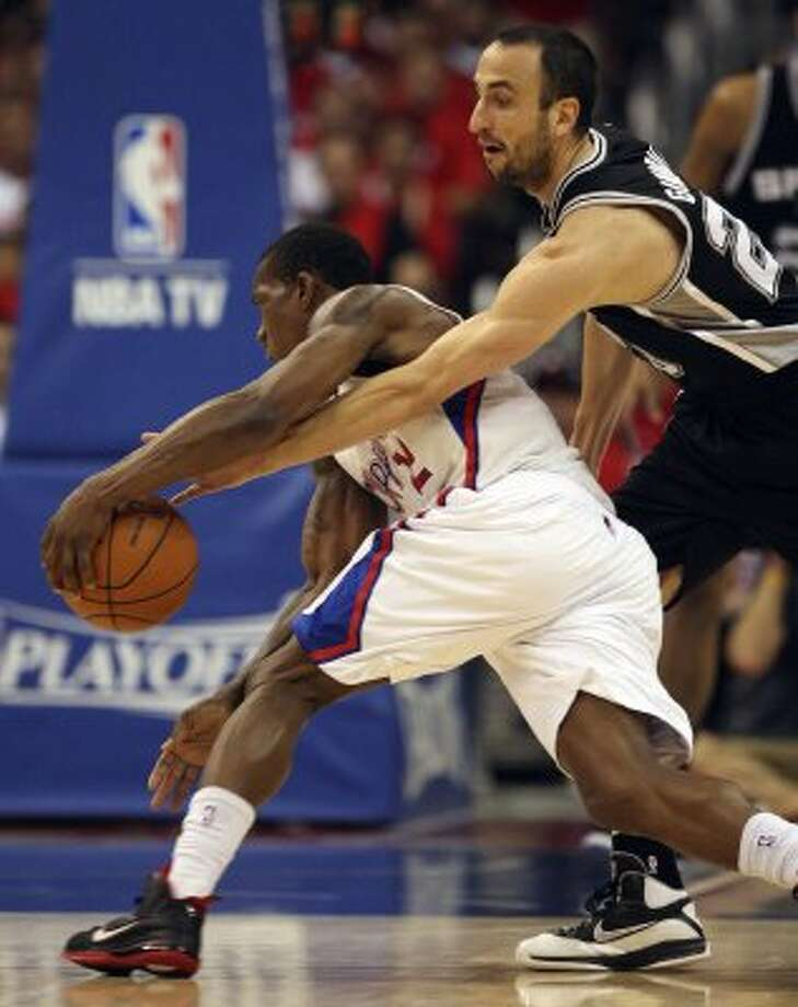 San Antonio Spurs Manu Ginobili (20), reaches try and steal the ball from Los Angeles Clippers Eric Bledsoe (12), during game four of the Western Conference semifinals at Staples Center in Los Angeles, Sunday, May 20, 2012.  Jerry Lara/San Antonio Express-News (Jerry Lara / San Antonio Express-News)