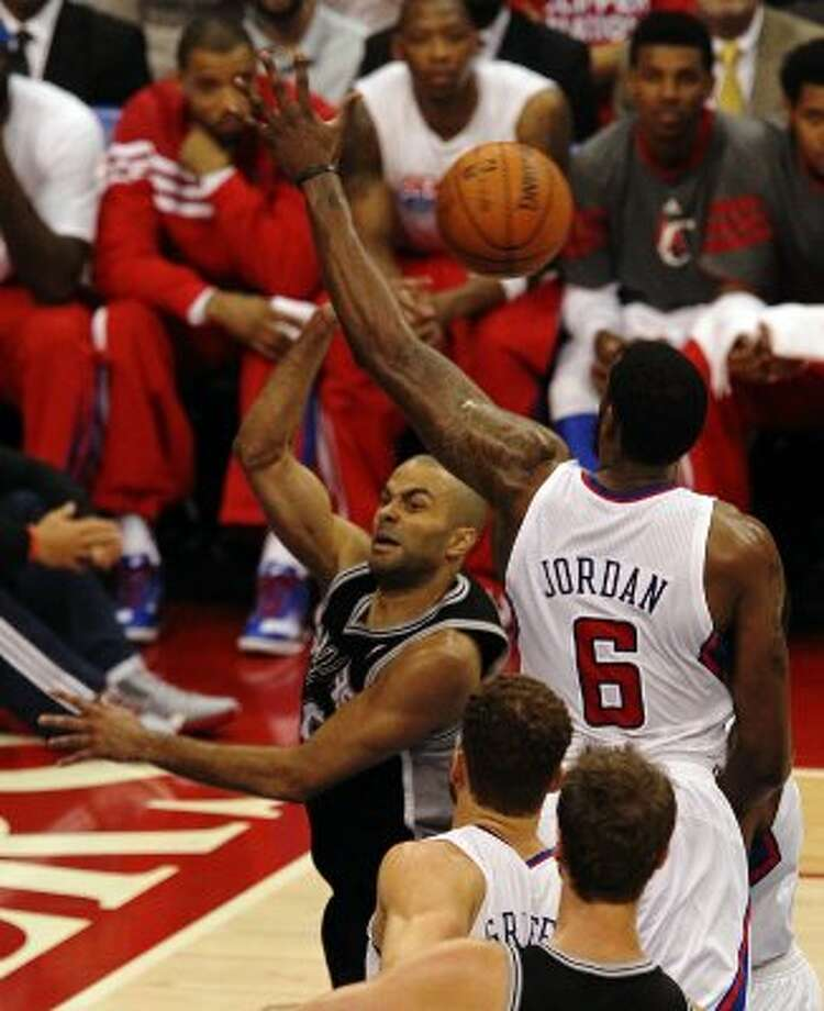Spurs' Tony Parker (09) makes a pass against the Los Angeles Clippers' DeAndre Jordan (06) in the second half of game four of the Western Conference semifinals at the Staples Center in Los Angeles on Sunday, May 20, 2012. Kin Man Hui/Express-News (Kin Man Hui / SAN ANTONIO EXPRESS-NEWS)