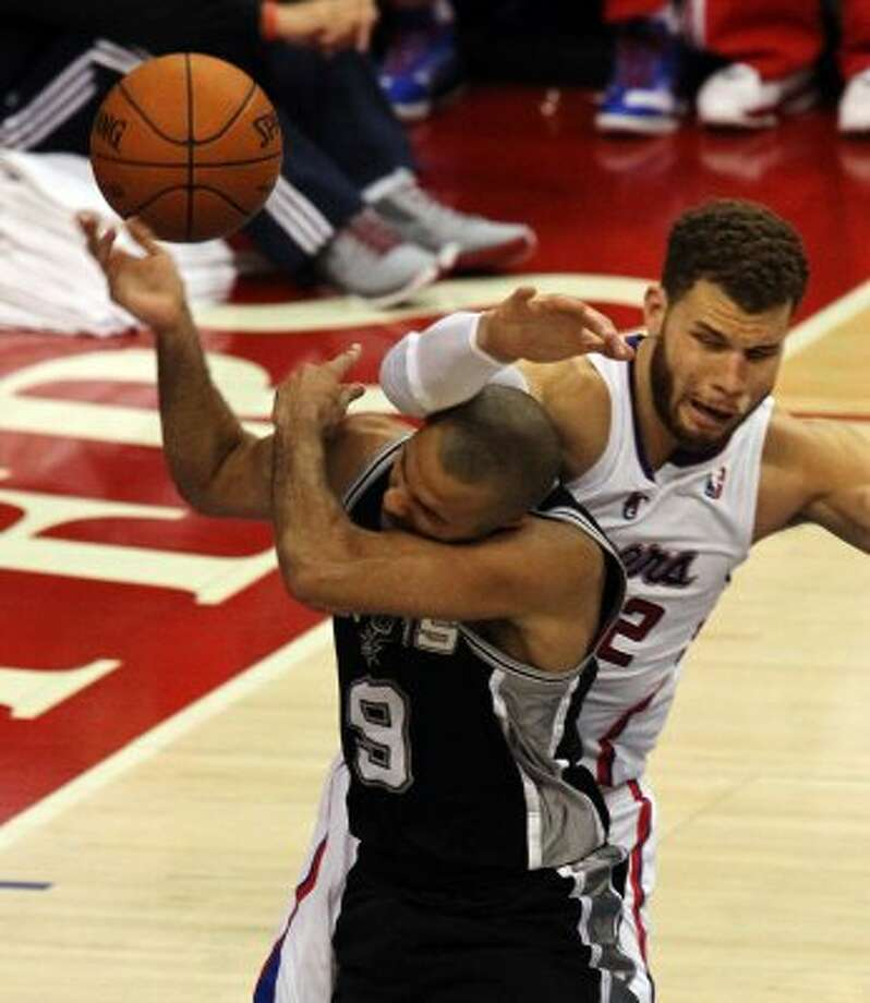 Spurs' Tony Parker (09) gets hammered by Los Angeles Clippers' Blake Griffin (32) in the second half of game four of the Western Conference semifinals at the Staples Center in Los Angeles on Sunday, May 20, 2012. Kin Man Hui/Express-News (Kin Man Hui / SAN ANTONIO EXPRESS-NEWS)
