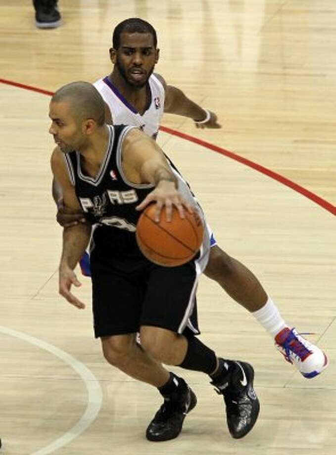 Spurs' Tony Parker (09) gets grabbed by the Los Angeles Clippers' Chris Paul (03) in the second half of game four of the Western Conference semifinals at the Staples Center in Los Angeles on Sunday, May 20, 2012. Kin Man Hui/Express-News (Kin Man Hui / SAN ANTONIO EXPRESS-NEWS)