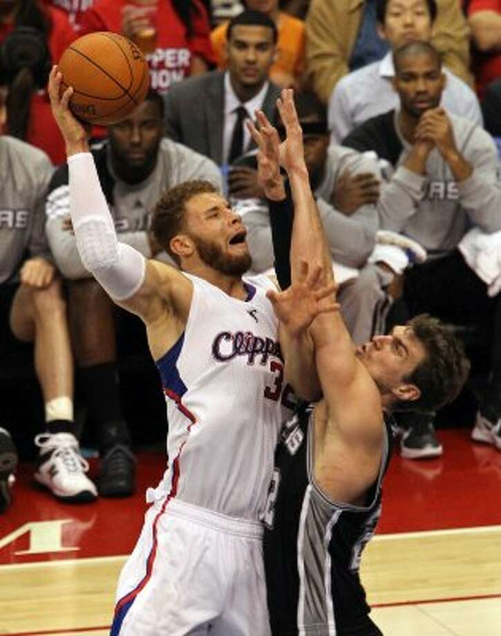Spurs' Tiago Splitter (22) attempts to defend against the Los Angeles Clippers' Blake Griffin (32) in the second half of game four of the Western Conference semifinals at the Staples Center in Los Angeles on Sunday, May 20, 2012. Kin Man Hui/Express-News (Kin Man Hui / SAN ANTONIO EXPRESS-NEWS)