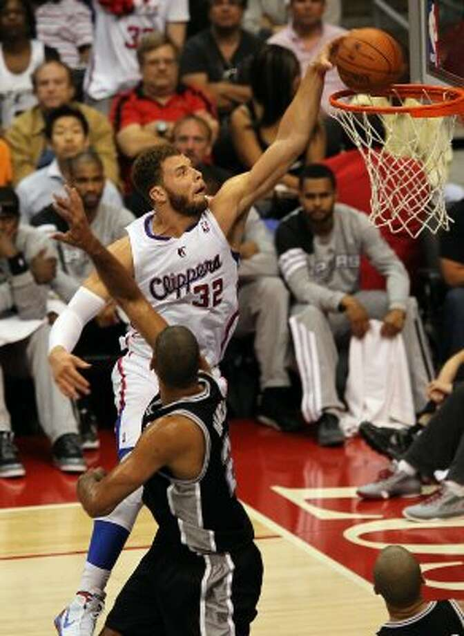 Los Angeles Clippers' Blake Griffin (32) dunks on Spurs' Tim Duncan (21) in the second half of game four of the Western Conference semifinals at the Staples Center in Los Angeles on Sunday, May 20, 2012. Kin Man Hui/Express-News (Kin Man Hui / SAN ANTONIO EXPRESS-NEWS)