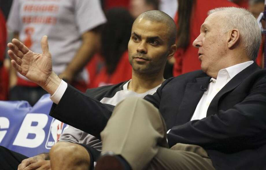 San Antonio Spurs' Tony Parker (09) talks with head coach Gregg Popovich during their game against the Los Angeles Clippers in the third quarter of game four of the Western Conference semifinals at Staples Center in Los Angeles, Sunday, May 20, 2012.  Jerry Lara/San Antonio Express-News (Jerry Lara / San Antonio Express-News)