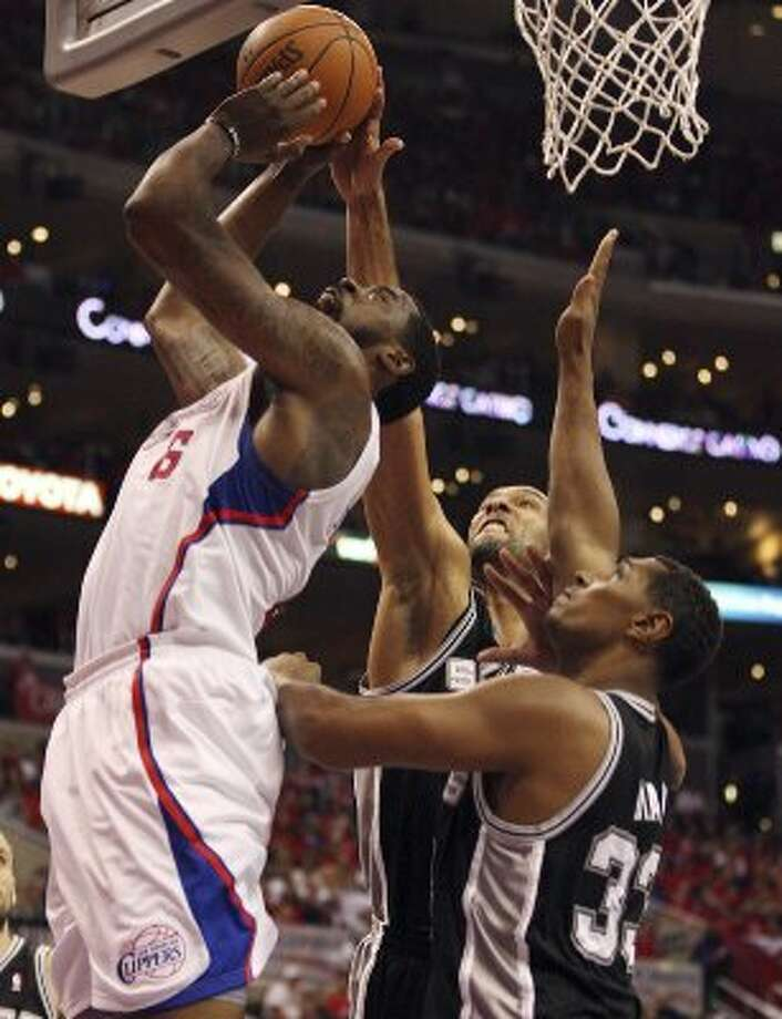 San Antonio Spurs' Tim Duncan (21) and Boris Diaw (33) attempt to block a shot by Los Angeles Clippers' DeAndre Jordan (06) in the third quarter of game four of the Western Conference semifinals at Staples Center in Los Angeles, Sunday, May 20, 2012.  Jerry Lara/San Antonio Express-News (Jerry Lara / San Antonio Express-News)