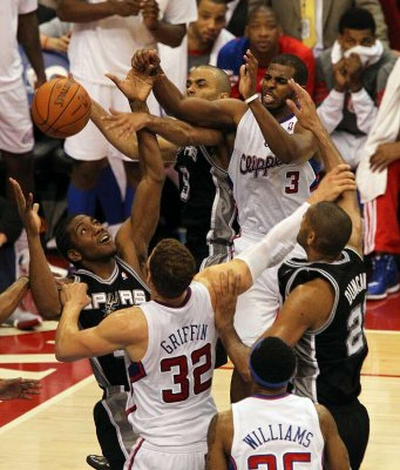 Spurs' Kawhi Leonard (02), Tony Parker (09) and Tim Duncan (21) battle Los Angeles Clippers' Chris Paul (03) and Blake Griffin (32) for a loose ball in the fourth quarter of game four of the Western Conference semifinals at the Staples Center in Los Angeles on Sunday, May 20, 2012. Spurs defeated the Clippers 102-99. Kin Man Hui/Express-News (SAN ANTONIO EXPRESS-NEWS)