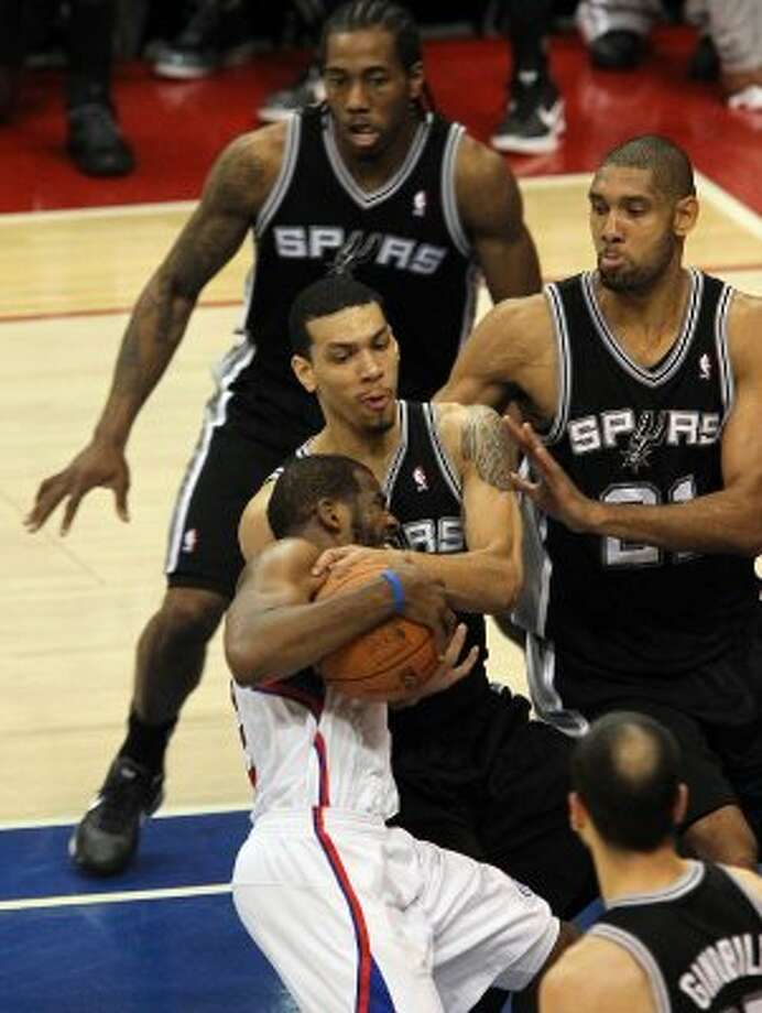 Spurs' Danny Green (04) wraps up Los Angeles Clippers' Chris Paul (03) as Spurs teammates Tim Duncan (21) and Kawhi Leonard (02) close in to help in the fourth quarter of game four of the Western Conference semifinals at the Staples Center in Los Angeles on Sunday, May 20, 2012. Spurs defeated the Clippers 102-99. Kin Man Hui/Express-News (SAN ANTONIO EXPRESS-NEWS)