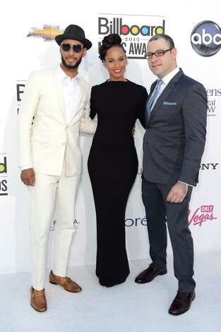 LAS VEGAS, NV - MAY 20:  Producer Swizz Beatz, singer Alicia Keys and Billboard's Editorial Director Bill Werde arrive at the 2012 Billboard Music Awards held at the MGM Grand Garden Arena on May 20, 2012 in Las Vegas, Nevada. Photo: Frazer Harrison, Getty Images For ABC / 2012 Getty Images