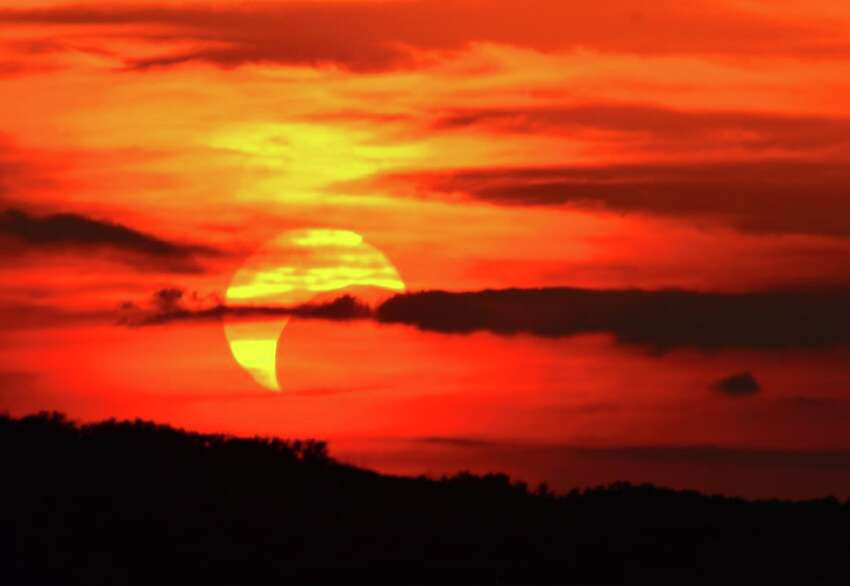 May 20th's partial solar eclipse. Photo taken near sunset from Stone Oak area. Nikon D7000, 300mm lens, ISO 100, 1/50th at f/15. Photo by Bob Kelley/Coordinator Scobee Planetarium