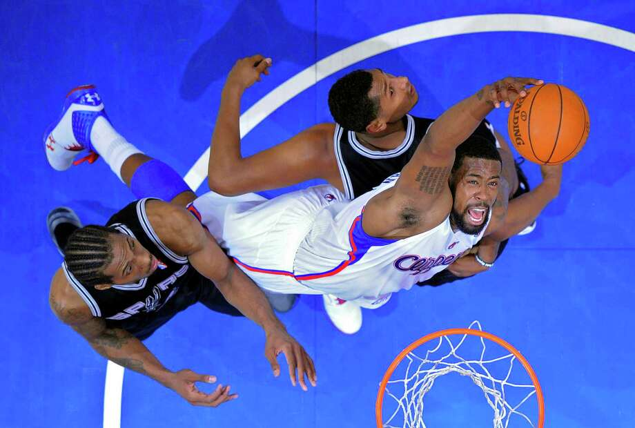 Los Angeles Clippers center DeAndre Jordan, right, grabs a rebound away from San Antonio Spurs forward Kawhi Leonard, left, and forward Boris Diaw of France during the first half in Game 4 of an NBA basketball playoffs Western Conference semifinal, Sunday, May 20, 2012, in Los Angeles. The Spurs won the game and swept the series, 4-0. (AP Photo/Mark J. Terrill) Photo: Mark J. Terrill, Associated Press / AP