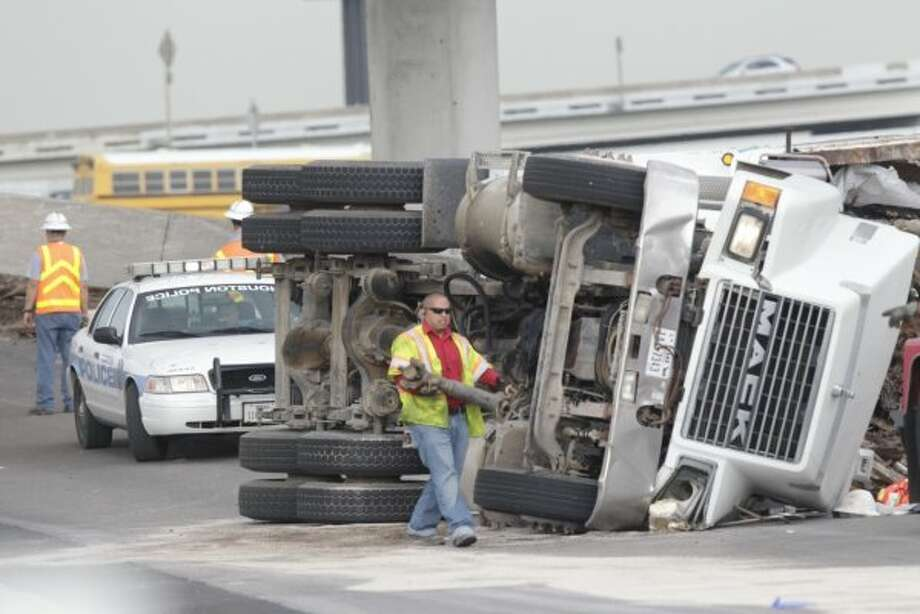 Traffic was snarled on Interstate 45 in southeast Houston after a truck turned over and lost a load of metal on the ramp to the 610 Loop Monday morning. (Mayra Beltran\Chronicle)