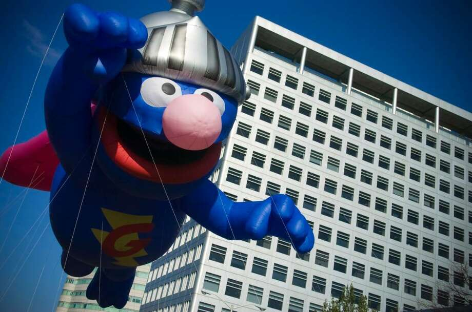 Super Grover fies down Atlantic St. during the UBS Parade Spectacular in Stamford, Conn. on Sunday, Nov. 22, 2009. Photo: Chris Preovolos / Stamford Advocate