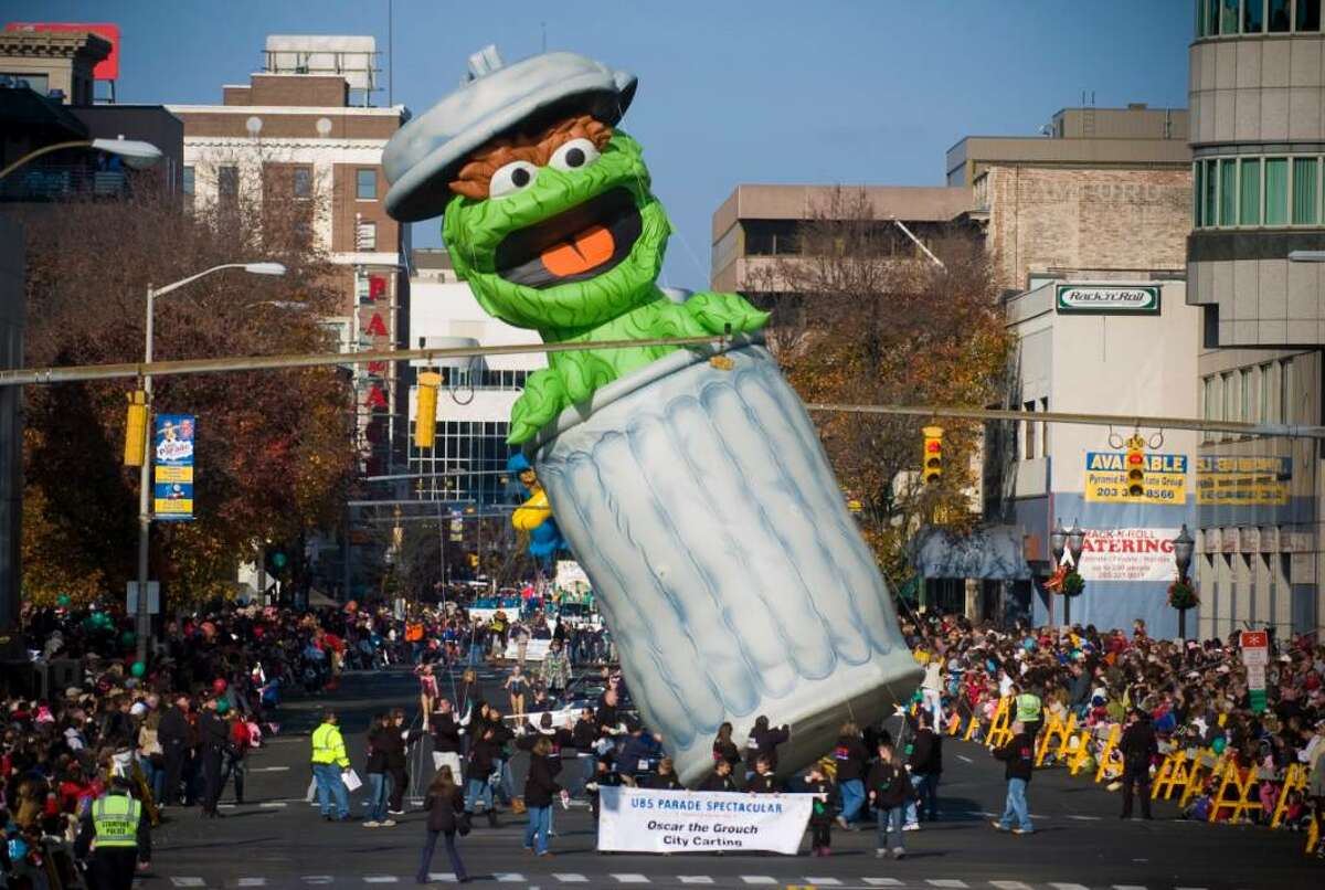 Oscar the Grouch limbos for a traffic light during the UBS Parade Spectacular in Stamford, Conn. on Sunday, Nov. 22, 2009.
