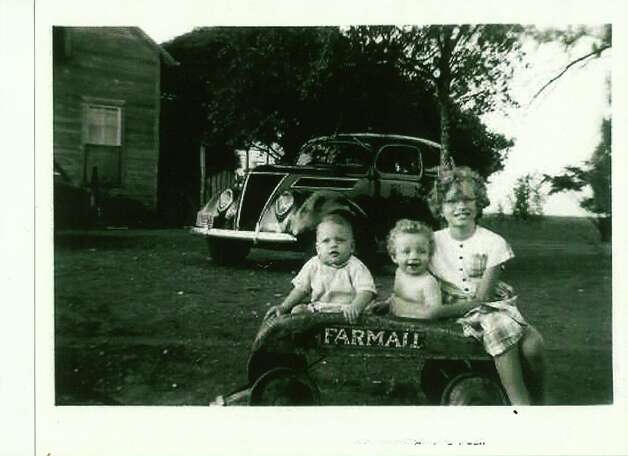 Summer 1949, Bill Gros, Albert Karnowski, Theresa Gros, at Karnowski grandparents place, Violet, Tex., for a family reunion. Bill and Theresa lived in San Antonio; Albert lived in Boise, Idaho. Bill and Theresa are brother and sister; Albert is a first cousin. All are grandchildren of Frank Karnowski and Emma Hoelscher Karnowski Photo: COURTESY