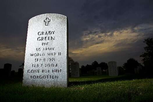 The grave of Grady Green, WWII veteran, buried at Houston National Cemetery. This veteran had his money stolen by a Houston woman who was supposed to protect him. She got $5,000 to buy him a burial plot and instead blew it on her own bills. Here's a look at other cases from all across Texas (Karen Warren / Houston Chronicle)